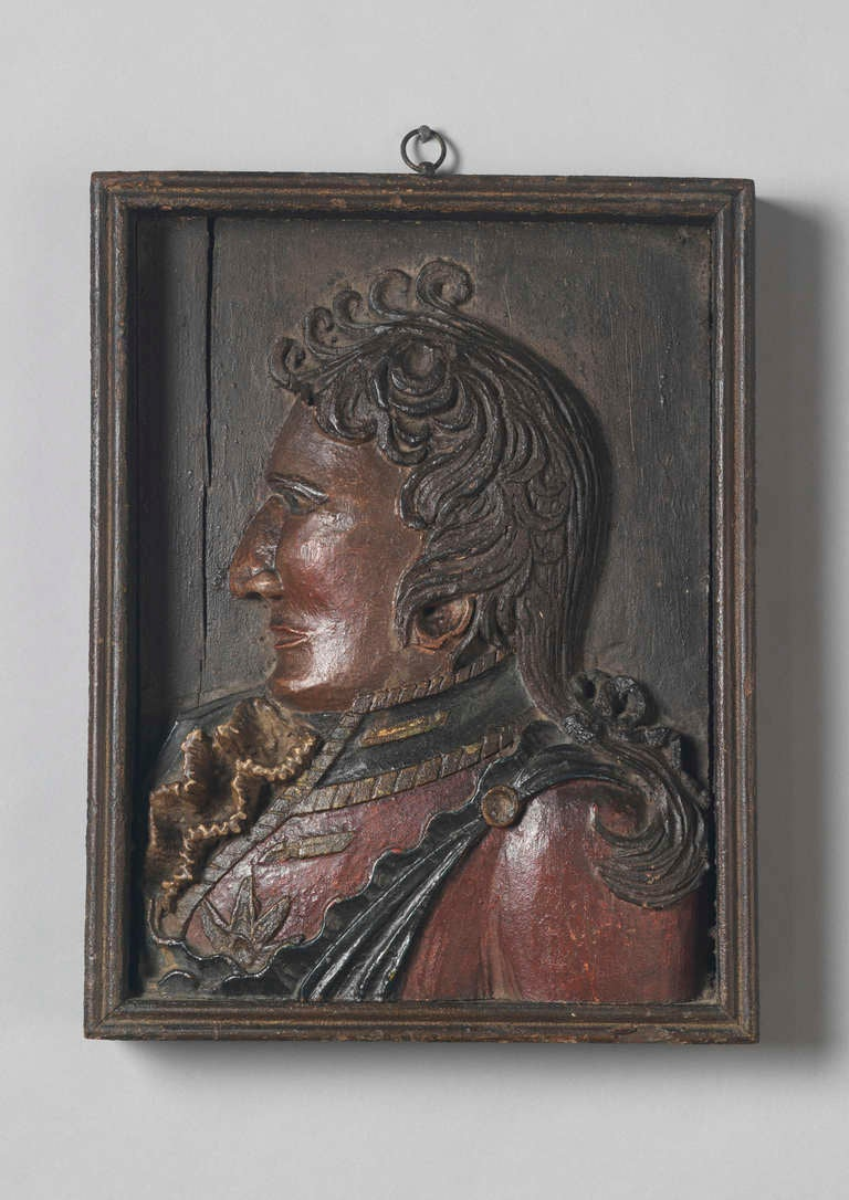 Relief carved portrait of a uniformed officer dated