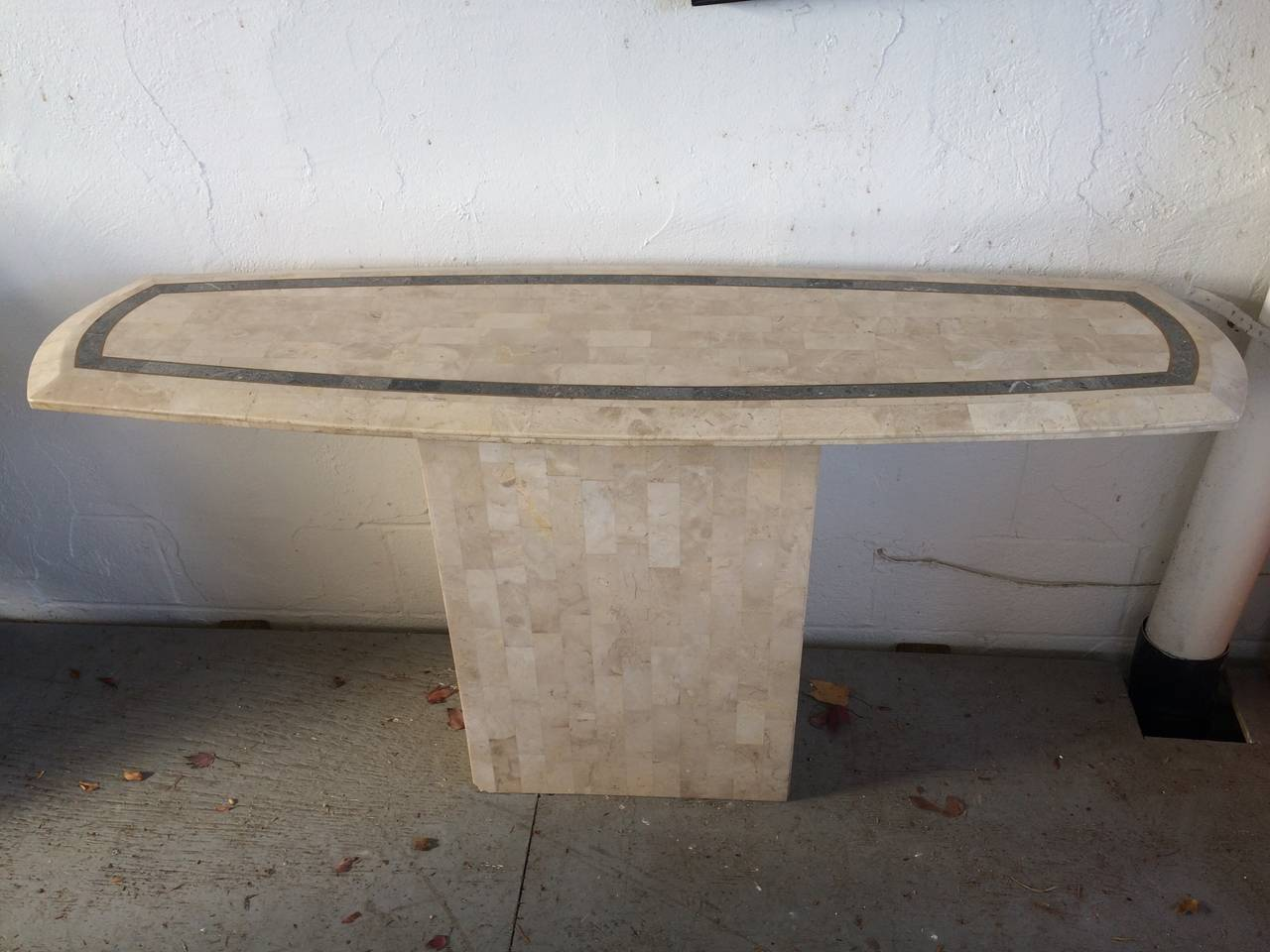 Maitland-Smith tessellated fossil/stone console table with banded inlay.