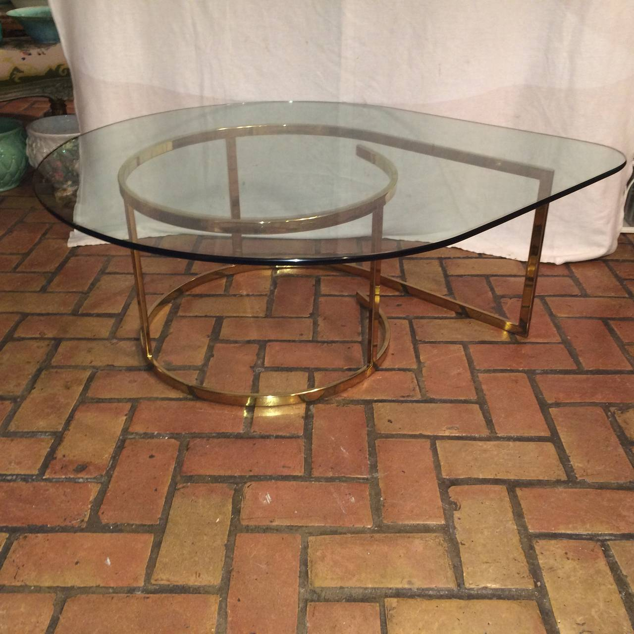 Late 20th Century Hollywood Regency Brass and Glass Coffee Table For Sale