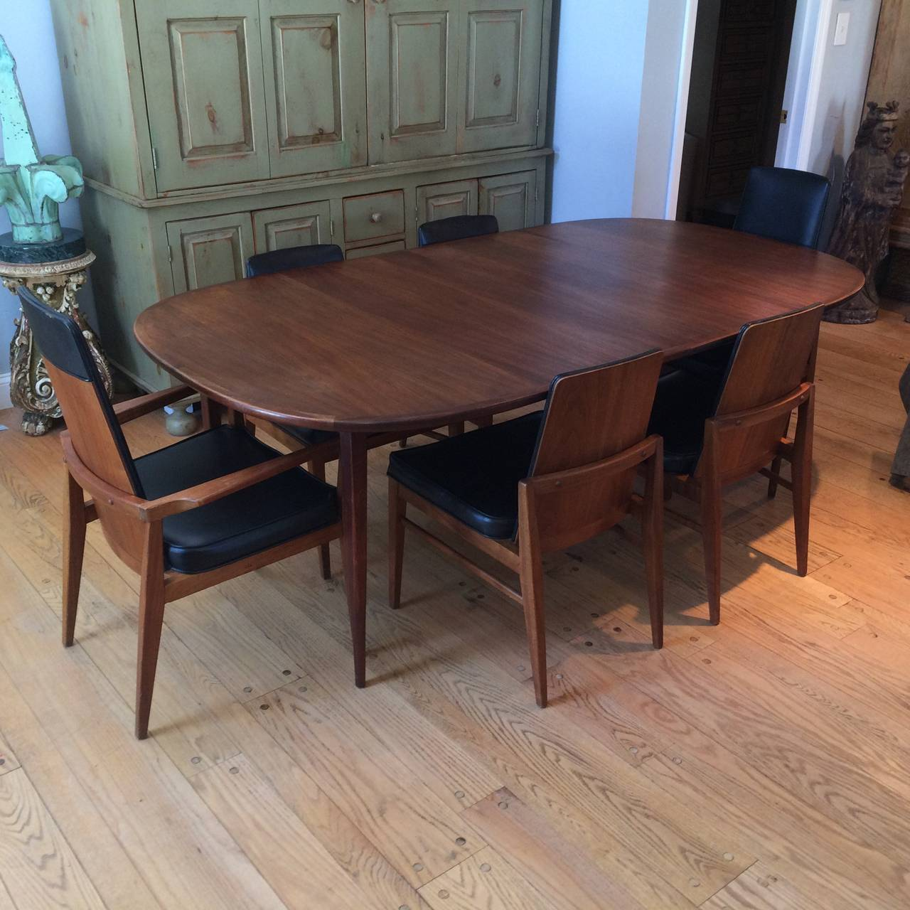this mid century modern walnut dining set is no longer available