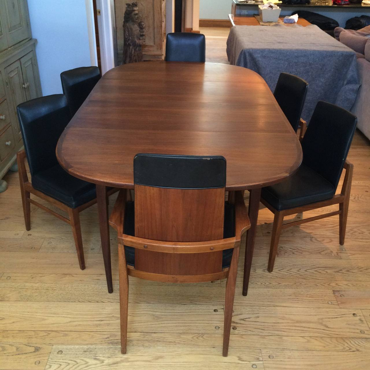 Mid century modern walnut dining set at 1stdibs for Modern dining room sets