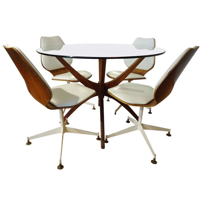 Adrian pearsall jax dining table with bentwood swivel for Dining room table with swivel chairs