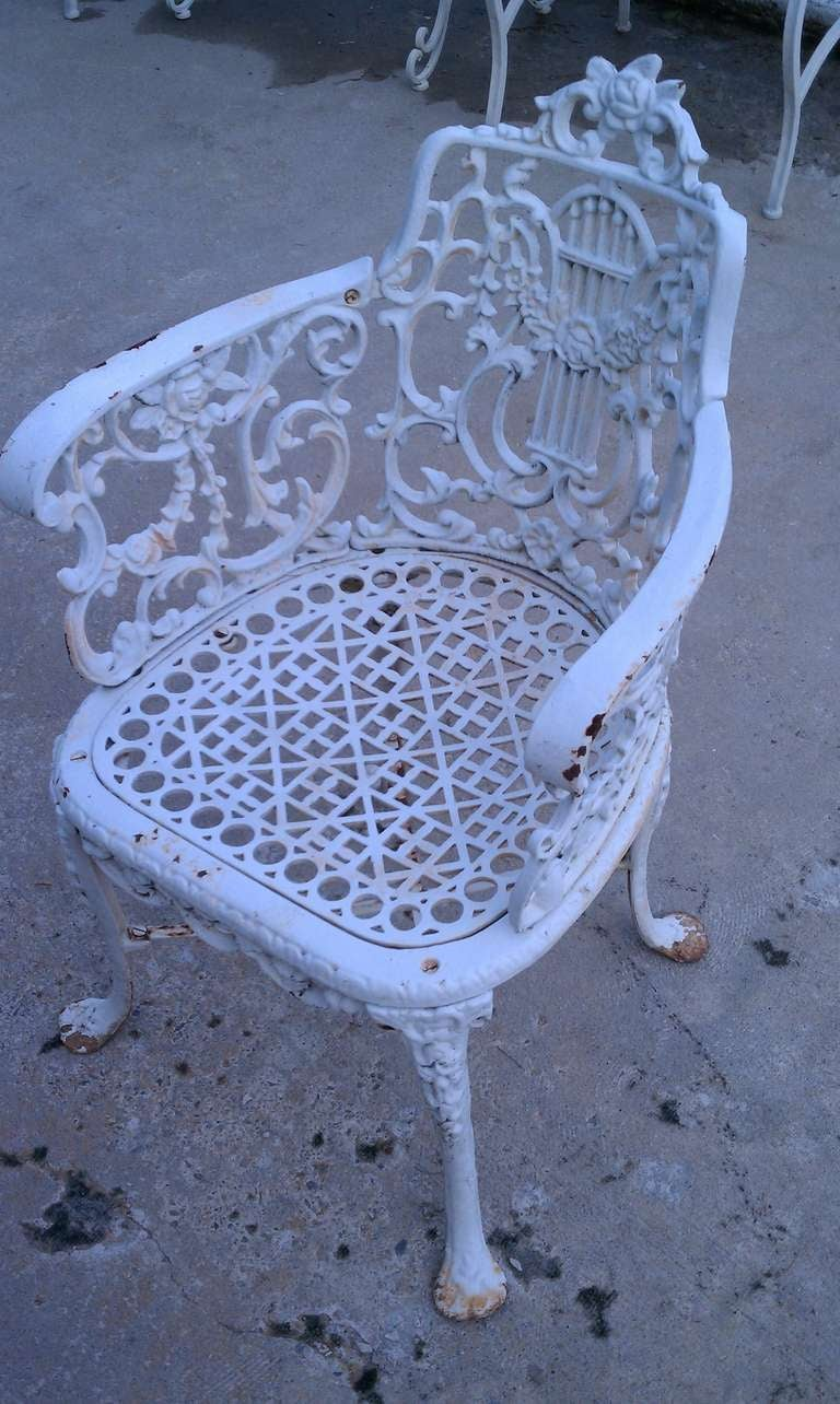 this antique neoclassical cast iron patio set is no longer available