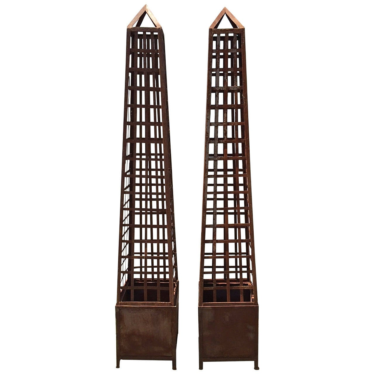 Pair of Monumental Iron Latticework Obelisks with Planters