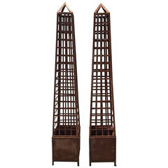 Pair of Monumental Iron Latticework Obelisks with Planters