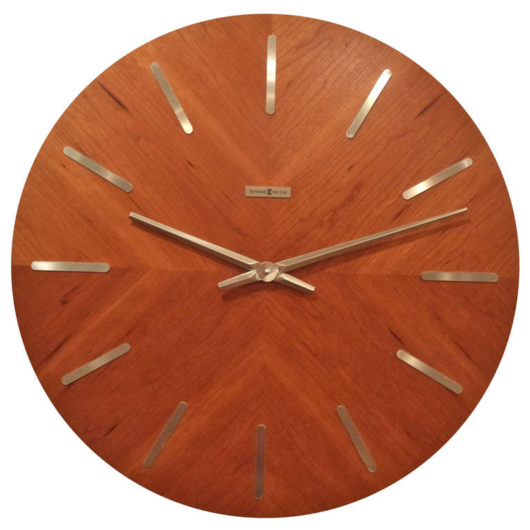 this mid century modern teak wall clock by howard miller is no longer