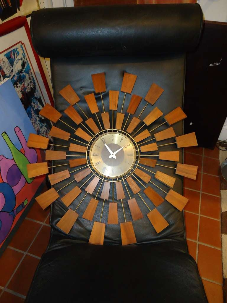 this mid century modern starburst wall clock is no longer available
