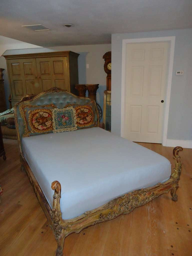 Antique carved Wooden French bed with tufted velvet headboard. Comes with custom mattress and box spring. This is ideal for a young girls bedroom. The mattress is in excellent condition and the box spring is in very good condition. Some scrapes on