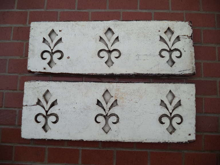 Pair of antique architectural Fleur de Lis carved panels with original paint.