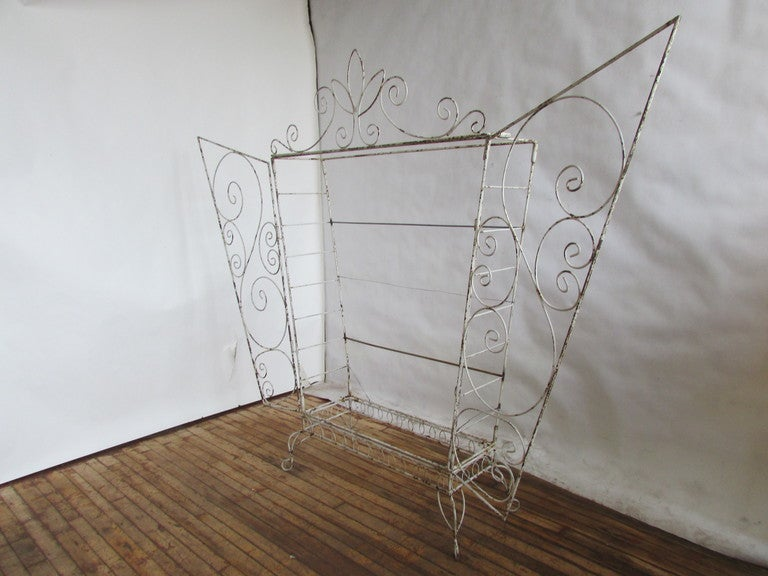 French old white painted metal wire winged door etagere, shelving, bakers rack in the style of Mathieu Mategot. Very unusual and whimsical sculptural form. We have never seen another one like it. A true fantasy furniture piece. Constructed so