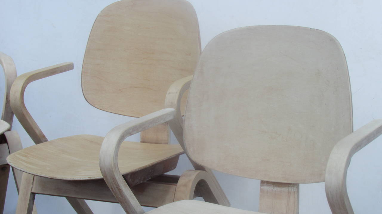 A set of four hard to find vintage Thonet bentwood armchairs designed by Joe Atkinson in a bleached pale parchment colored cerused finish, two chairs of the four are lighter with more of bleached bone white color. Paper labels present - Thonet - One