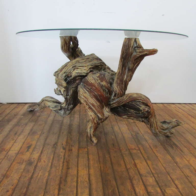 A heavy dense & sinuous single form natural driftwood redwood tree burl root shown as table base or display as sculpture. The old varnish has oxidized over a long period of time giving the wood a weathered ancient looking color patina. Beyond