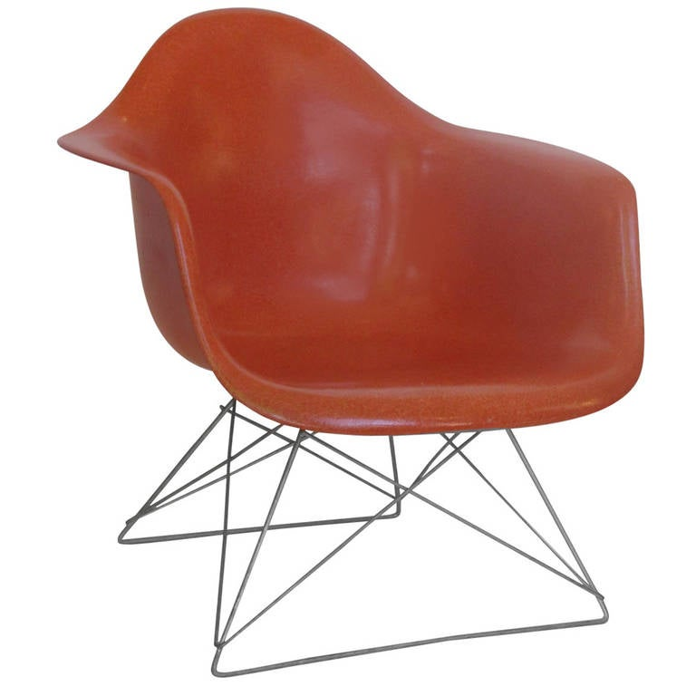 this eames red orange lar chair with cats cradle base is no longer