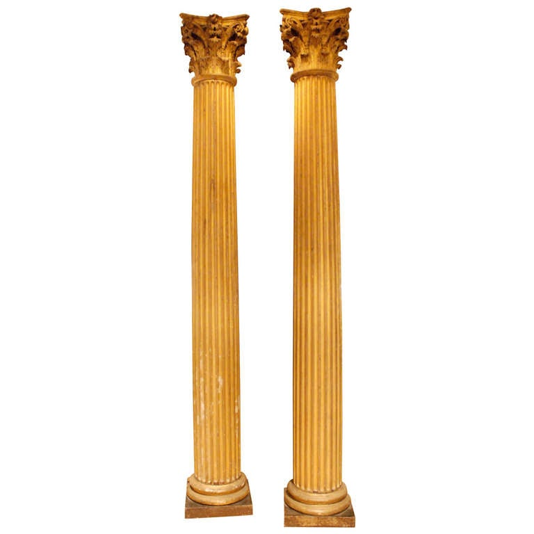 Pair of dramatic classical carved giltwood fluted columns