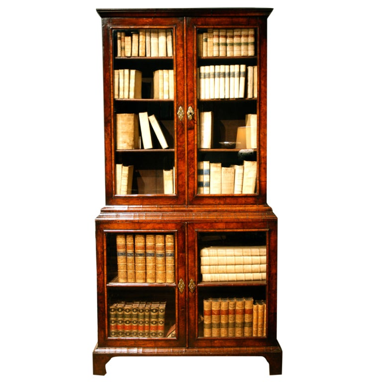 A rare early 18th Century veneered walnut display cabinet/ bookcase 1