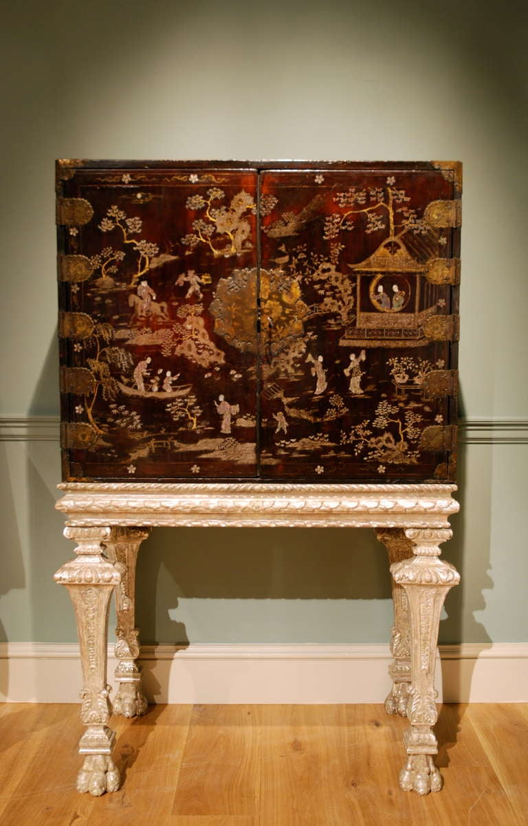 A Late 17th Century Chinese Lacquer Cabinet On Its 18th Century Silvered  Stand 2