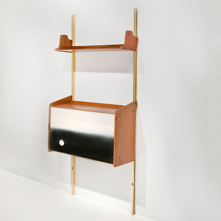 Shelving system with integrated drop-front bar or secretaire by Osvaldo Borsani,