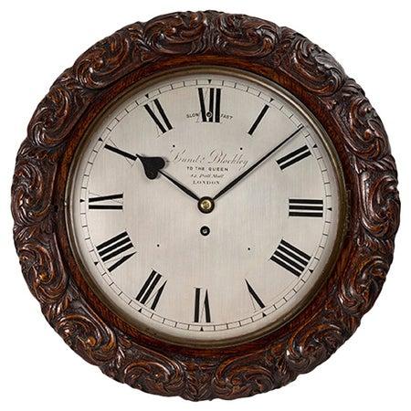 Victorian oak cased wall clock by Lund & Blockley, London