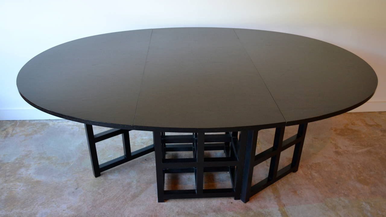 oval black drop leaf dining table by charles rennie