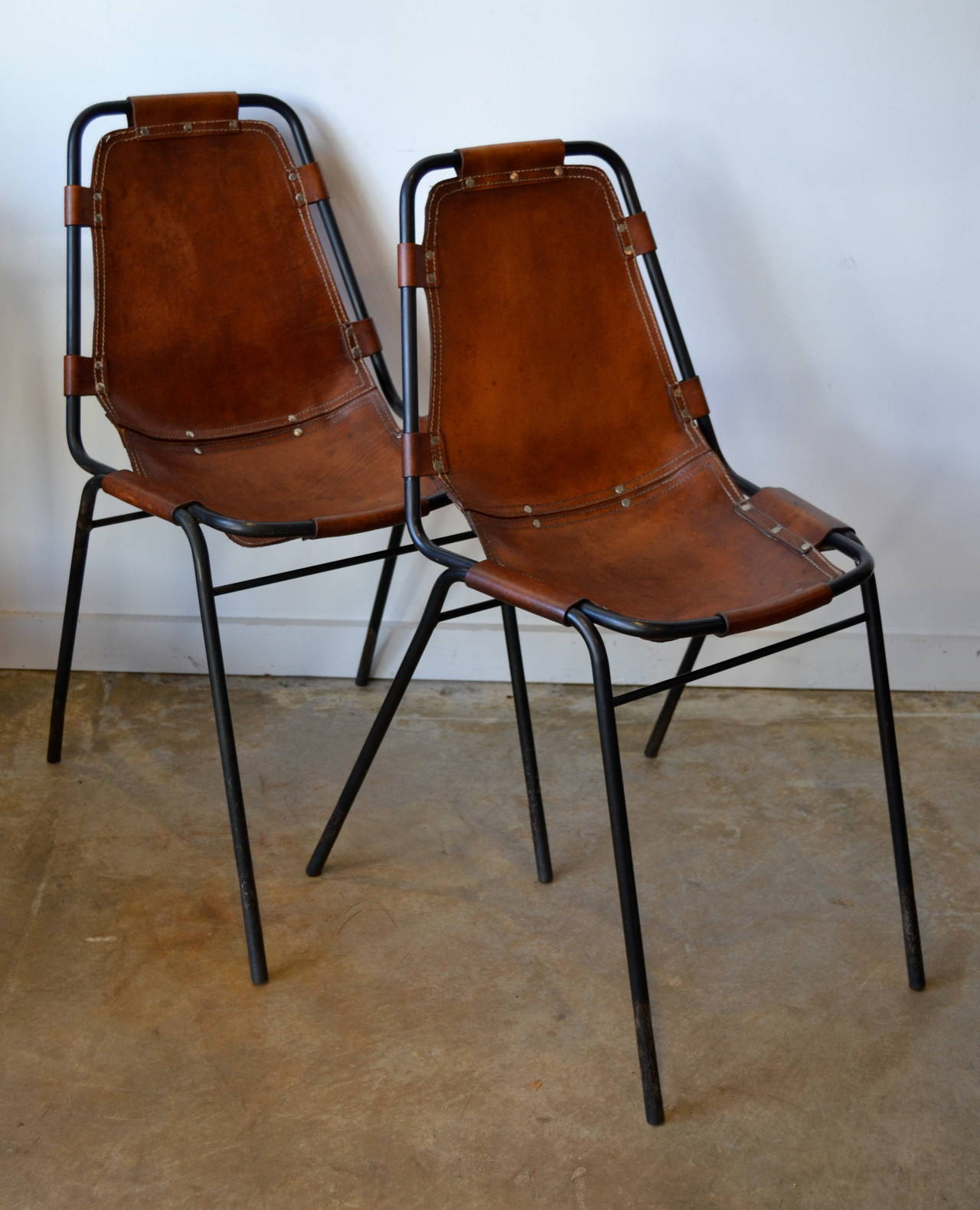 Black Metal Frame And Saddle Leather Side Chairs Designed By Charlotte  Perriand.