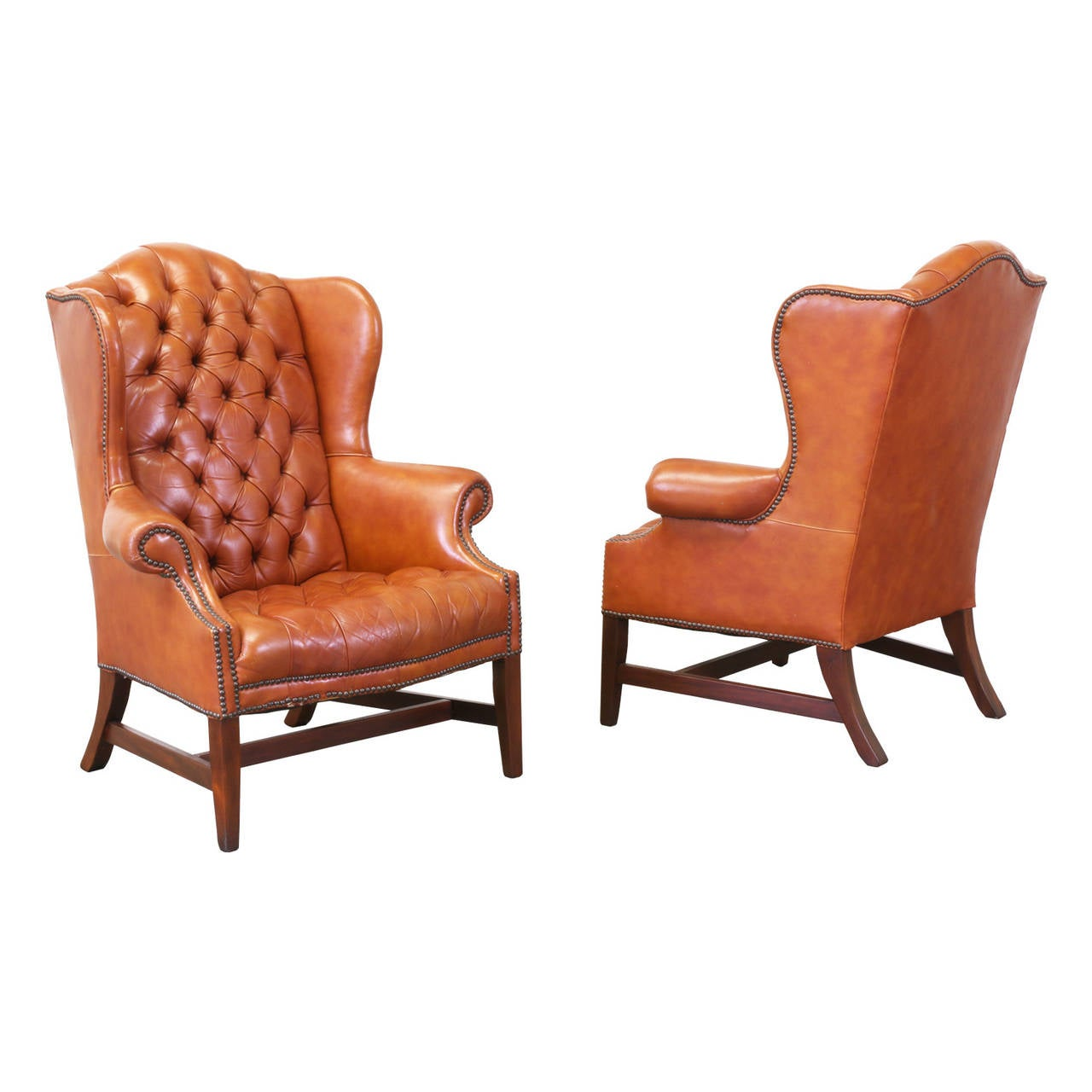 brass tacked tufted leather high back wing chairs 2
