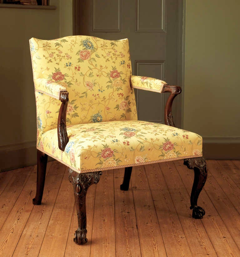 The carving to the front cabriole legs and arm supports is exemplary, and well reflects the period and rococo style fashionable during the second quarter of the 18th century. The proportions are faultless and the comfort supreme, being aided by