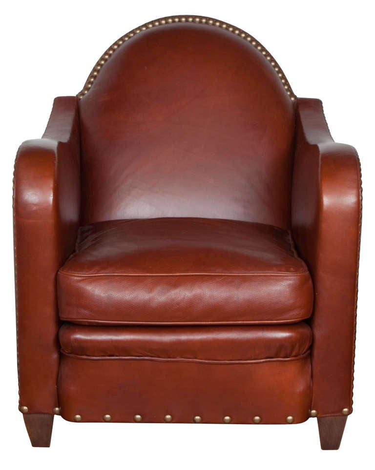 Art Deco style with round back, rounded arms leather lounge chair. Beautifully finished with nail studs. Excellent condition. Very comfortable.