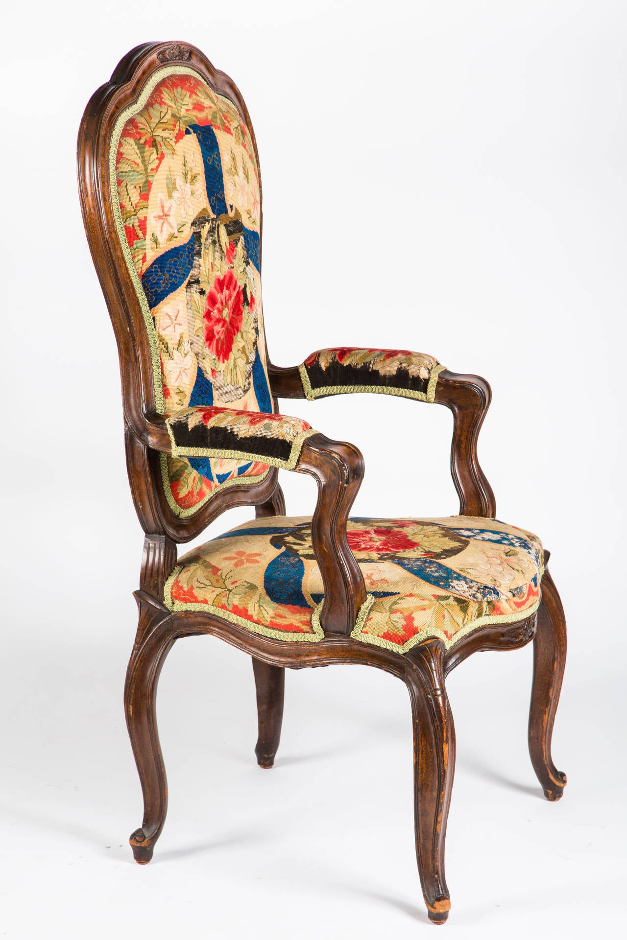 Stately tall back comfortable armchair. Graceful cabriole legs. Upholstered in beautiful needlepoint tapestry. Great accent chair.