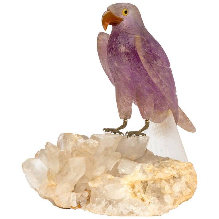 Amethyst carved bird on crystal quartz rock