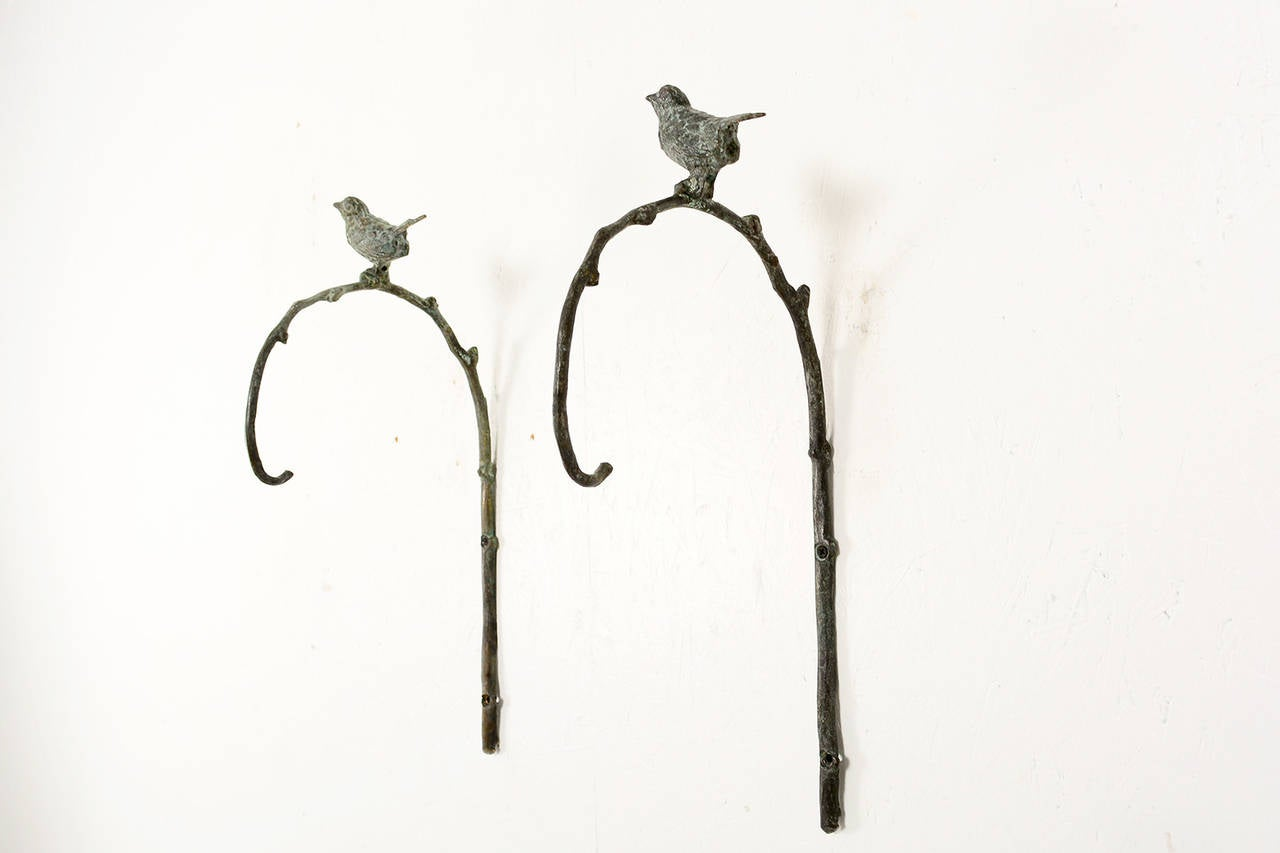 pair of bronze wall hanging sconces in the manner of
