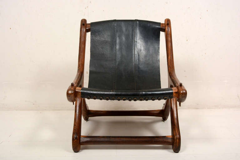 We are pleased to offer a vintage sling chair designed and produced by Don Shoemaker.  Rare solid Cocobolo frame with black leather sling seat. Ghost shadow is present where the original label used to be.  Dimensions: 27.25 in.Hx23.25 in.Wx26 in.D,