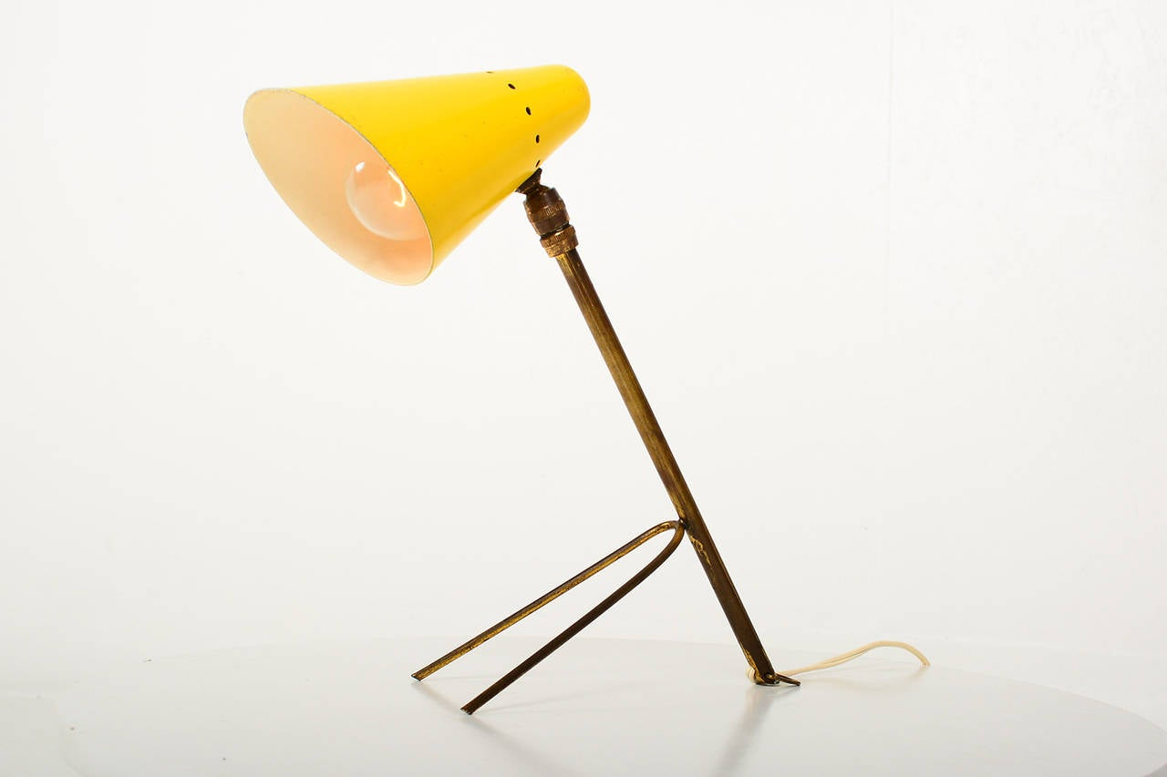 For your consideration a vintage French table or wall lamp.  The table has a tripod base that can be placed in a table top, or a hook that allows is to attach to a wall with a bracket (not included). Brass body with spun aluminum shade in yellow