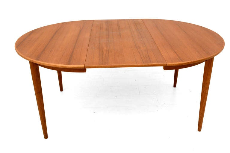 For your consideration a vintage modern dining table. Constructed with teak wood and two removable shelves. 