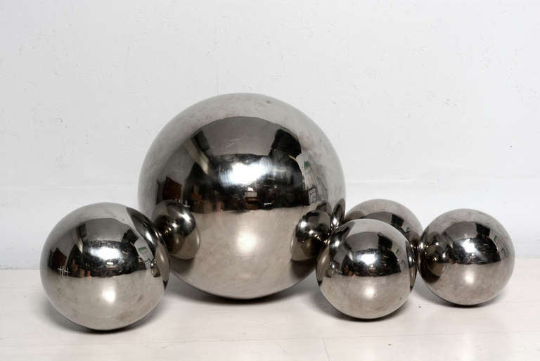 For your consideration a set of five sphere sculpture by Diego Matthai.  Spheres h.  The large sphere has the signature from Matthai in the center. One large one 17