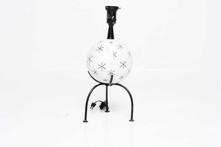 For your consideration a single ceramic table lamp. White ceramic sphere decorated with simple graphics in black and light green tones. Mounted in tropid base.   Shade not included.