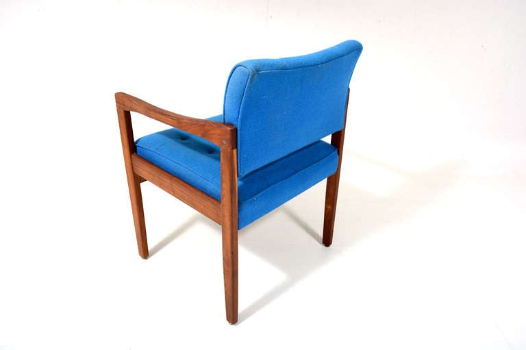 For your consideration a Mid-Century Modern office chair constructed with solid walnut frame.  Original upholstery in blue color.  Chair has built in armrest in sculptural shape.   Mounted in metal glides.