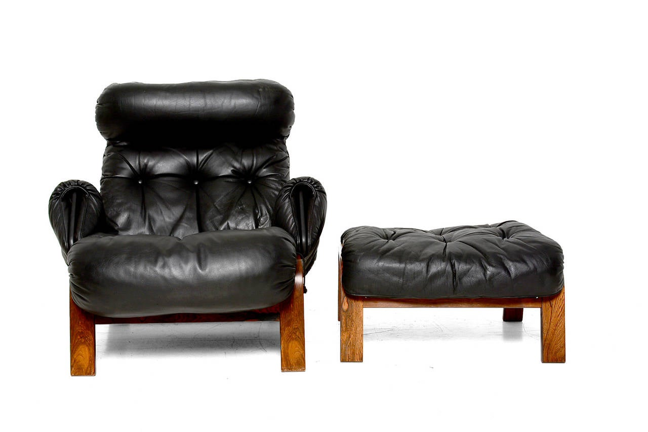 scandinavian lounge chair and ottoman in rosewood and black  - scandinavian lounge chair and ottoman in rosewood and black leather