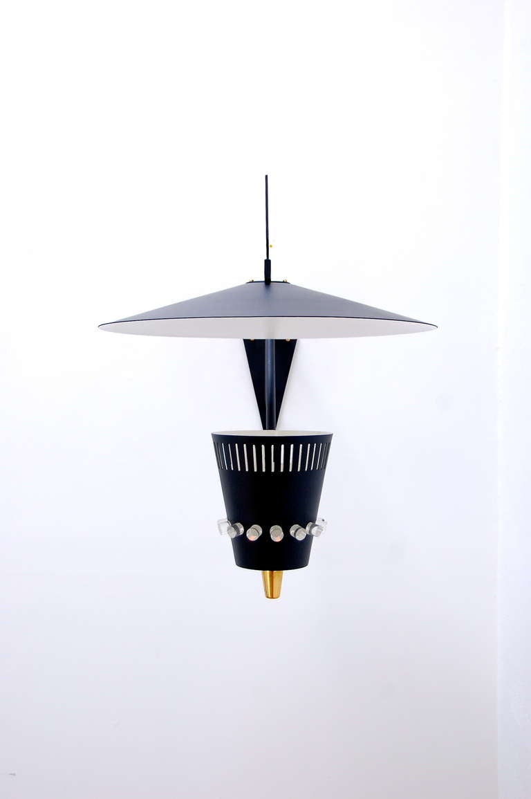 Large unique exterior wall sconce with lucite fitting details. Having high quality manufacturing, this sconce has a bold personality for exterior spaces.  Width: 20