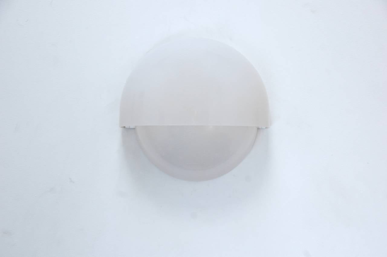 """(1) large """"Mania"""" sconce by Vico Magistretti for Artemide. Two opaline molded shells express the simple and clean shape of each sconce.   Large: ($1200) 11"""" H x 11"""" W x 5"""" D."""
