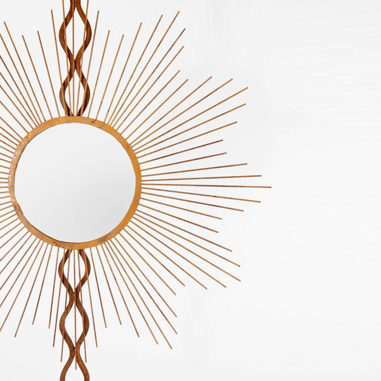 Pair of mirrors on sun shape, made in metal with golden patina with three-legged pedestal.