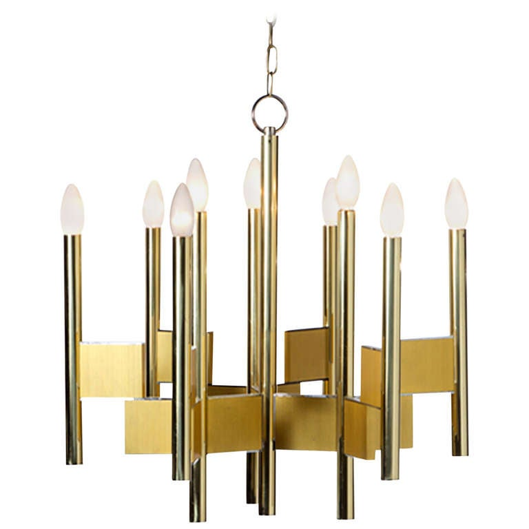 Pendant light designed by Gaetano Sciolari, made in matte and light brass composed by nine points light, Italy, 1970. Measures: 58 x 125 cm.