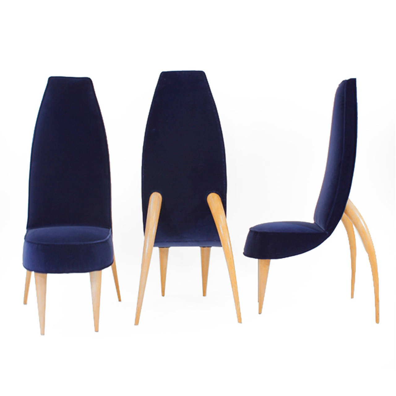 Set of six chairs made in solid wood upholstered in Klein blue cotton velvet legged in birch wood in zoomorphic form.