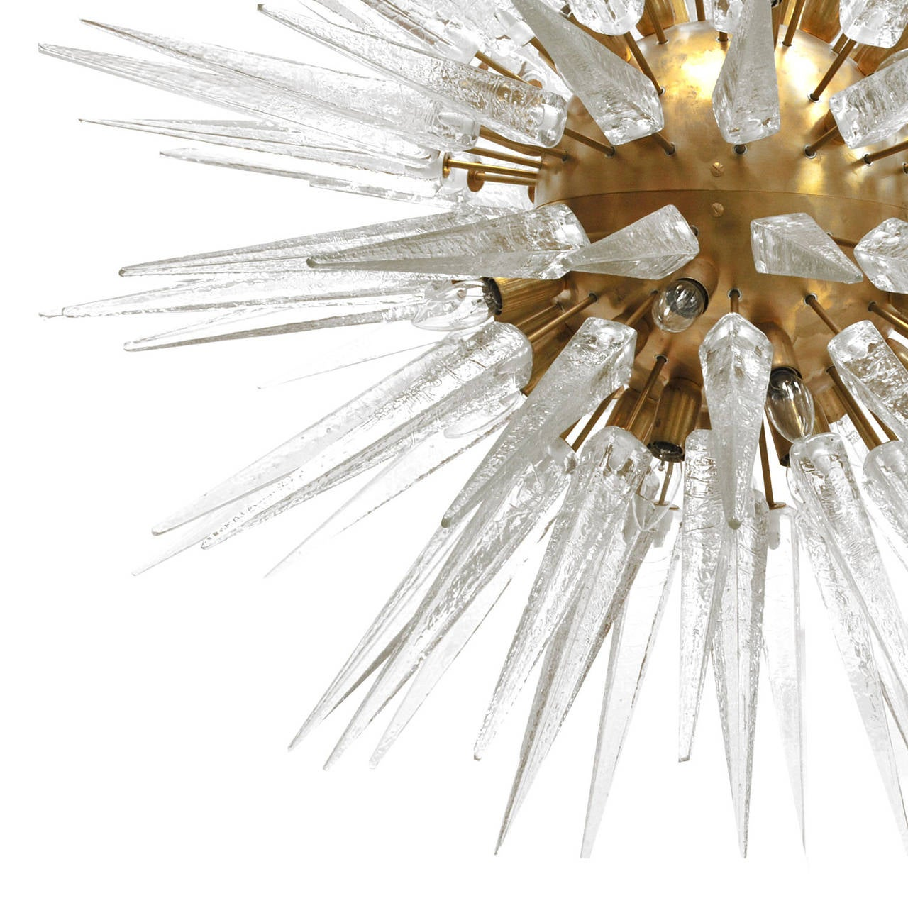 Suspension lamp with structure made in brass finished in solid Murano glass piece in pyramidal peak form.