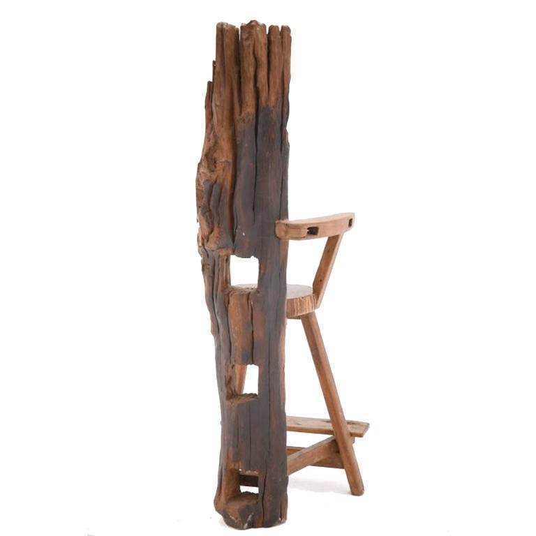 Sculpture of a chair made of walnut and olive wood, handcrafted with remnants of old farm implements, France, 1940s.