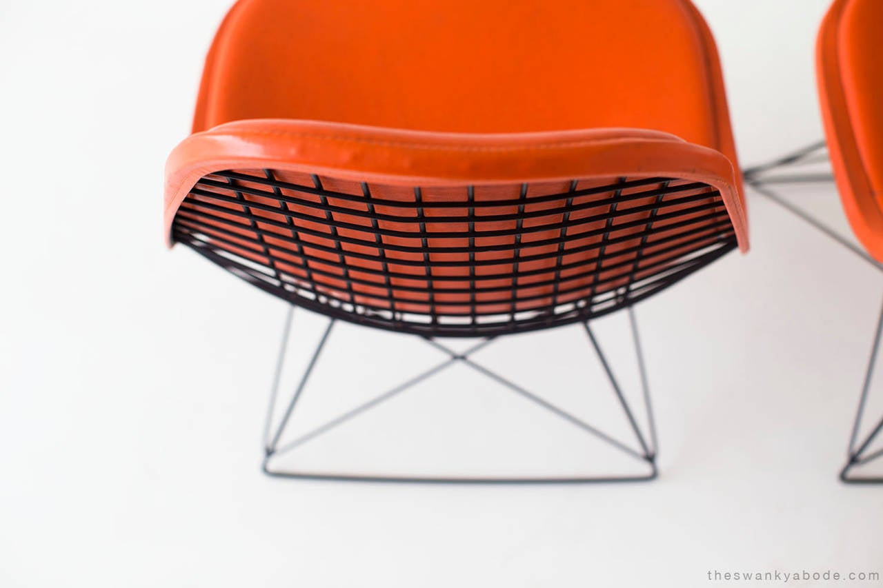 Designer: Ray and Charles Eames.  Manufacturer: Herman Miller. Period and model: Mid-Century Modern. Specifications: Metal, vinyl.   Condition:  These Ray and Charles Eames LKR-1 lounge chairs for Herman Miller are in very good vintage