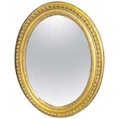 Early 19th Century Giltwood Oval Wall Mirror