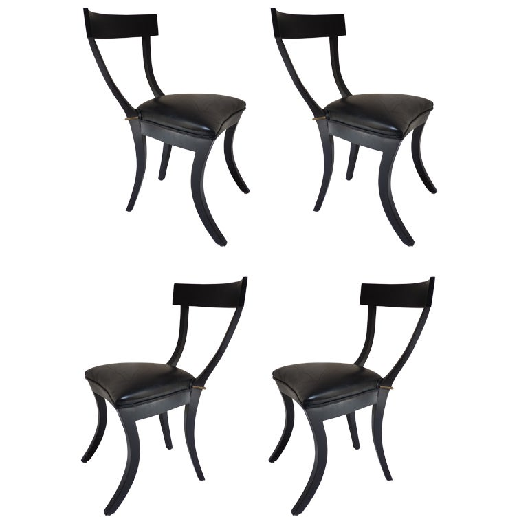 set of four black lacquer and gilt klismos dining chairs