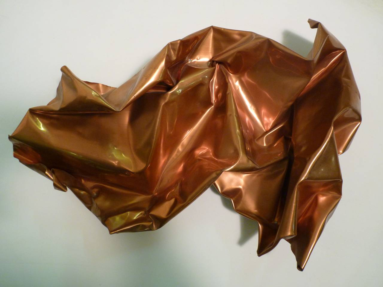 Wall mounted copper sculpture by jackson and ellamarie