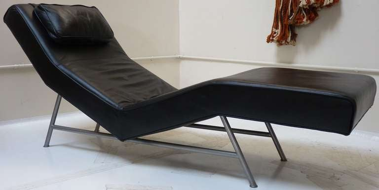 Milo Baughman #820-400 chaise longue in black leather. Piece retains original tags to underneath. Baughman designed this piece for Thayer Coggin in 1954. A low production re-issue occured in 1997 by Thayer Coggin- this is a re-issue from that