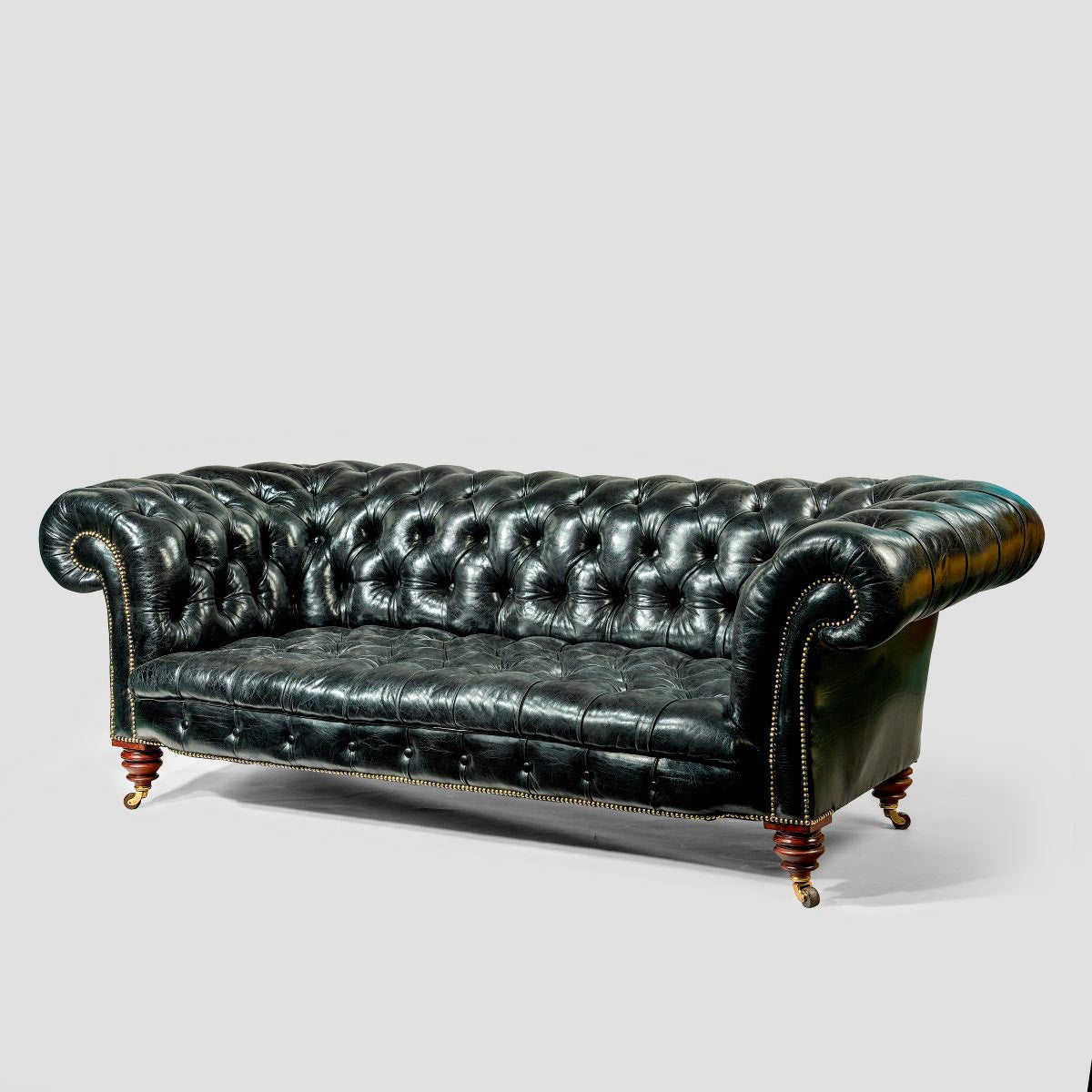 A pair of black leather chesterfield sofas by shoolbred at 1stdibs Leather chesterfield loveseat